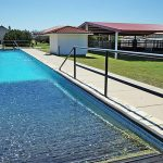 A 12 ft. deep X 10 ft. wide X 135 ft. long pool with ramps on each end for horses or lap swimmers (professionally cleaned each week).