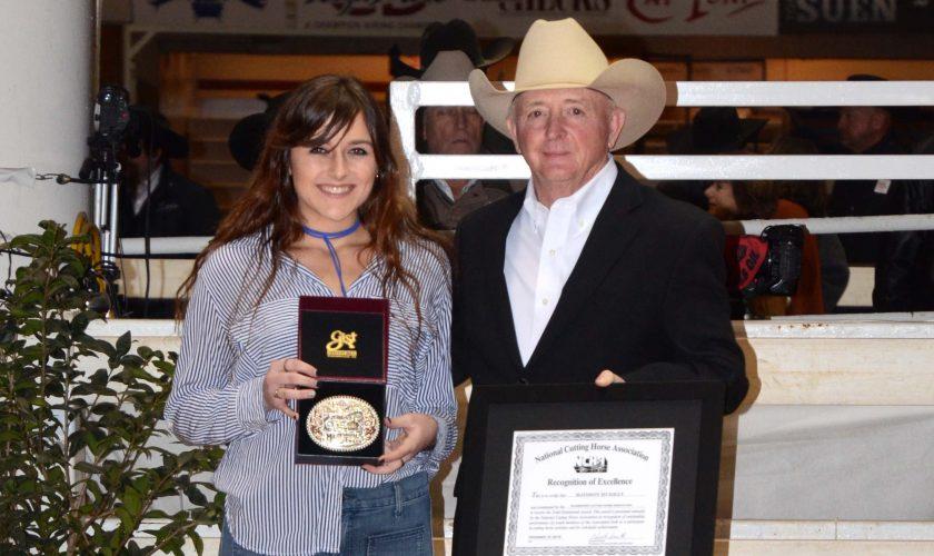 girl receiving award