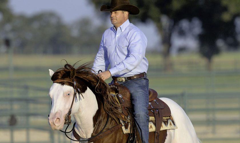 Man riding a horse.
