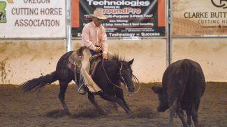"Breeding Giveaway winner Bob Kerby cutting on mare ""tootsie roll"""