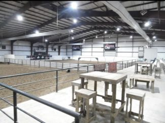 the inside of a horse arena