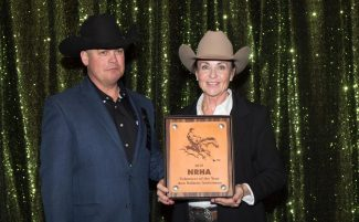 Woman holding an award
