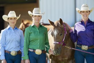 three women standing with horse wearing CR RanchWear shirts