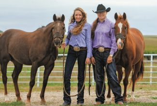 Reyly and Regan Plendl standing with their horses
