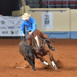 Trevor Hale astride Survive These Lips at the AQHYA reined cow horse at the World Championship Show in Oklahoma City.