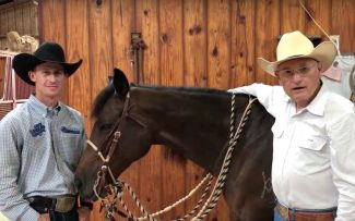 Wade Meador and Dennis Moreland demonstrating how to hold the reins with a 2 rein setup