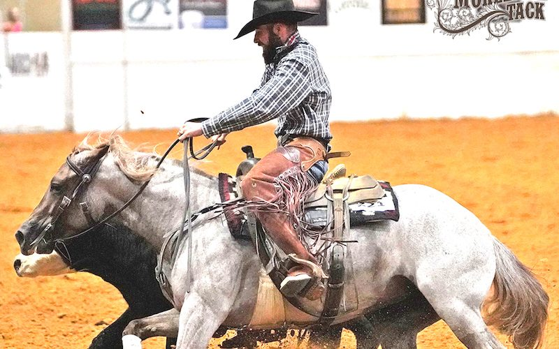 Clayton Anderson riding a horse using round buckle cinches