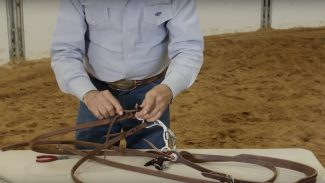 Dennis Moreland demonstrating how to tie on rein ends to your reins
