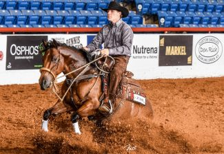 MoonshineAndTwoAdvil and Shawn Hays at the NRCHA Celebration of Champions