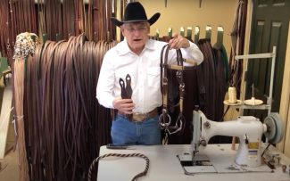 Dennis Moreland demonstrating how to attach mecate reins to a snaffle bit using slobber straps