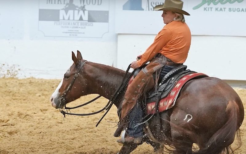 Lindy Burch using cutting horse spurs