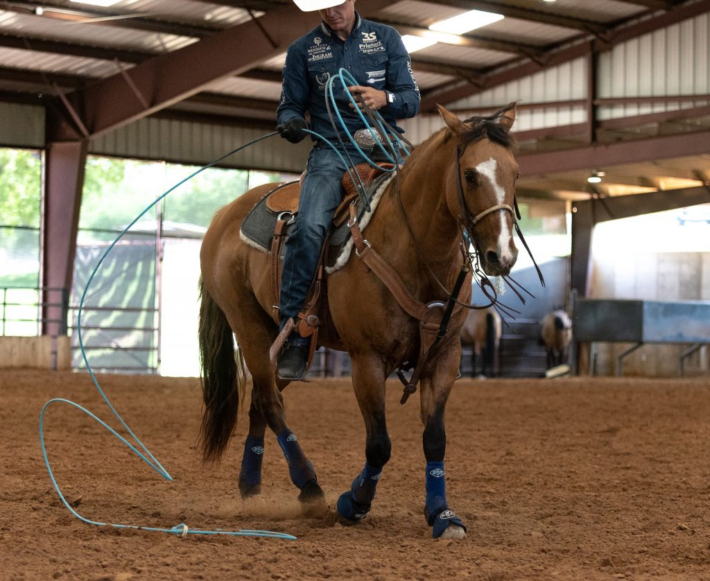 Patrick Smith riding in a Deluxe 100% wool saddle pad